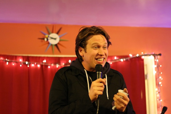 Pete Holmes antagonizing his friend who decided to play with her bead necklace during the set.
