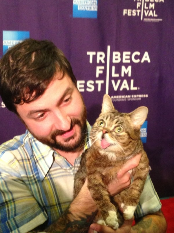 Lil Bub walks the red carpet with owner Mike Bridavsky. Photo by Christopher Snyder