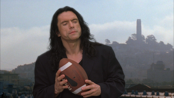 "Wiseau as ""Johnny"" playing football"